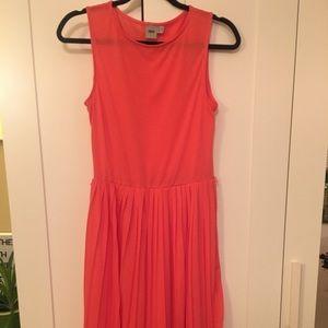 Orange knee length dress with pleats